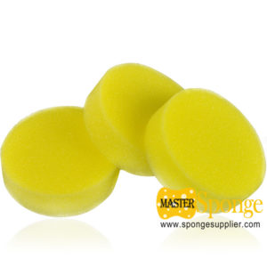 yellow round car waxing sponge